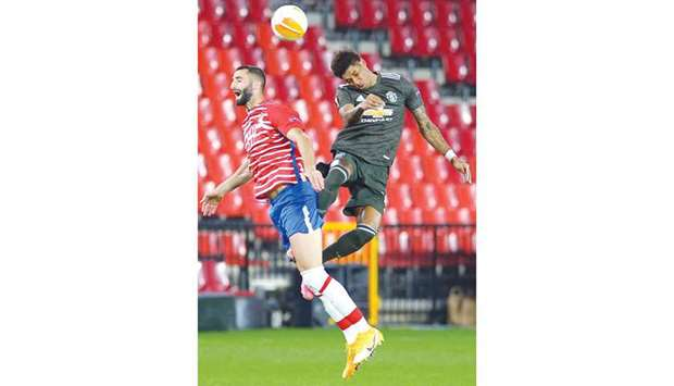 Granada's Maxime Gonalons (left) and Manchester United's Marcus Rashford go for a header during the