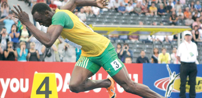 IAAF president Lamine Diack (below) feels that it's wrong to make Jamaican superstar Usain Bolt (abo