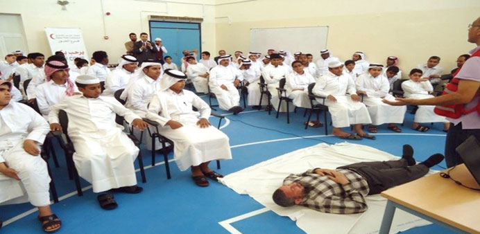 QRC presents a demonstration of first aid techniques to students.