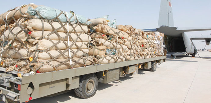 A trailer carrying flood aid to Sudan waits to be unloaded at Doha airport yesterday.