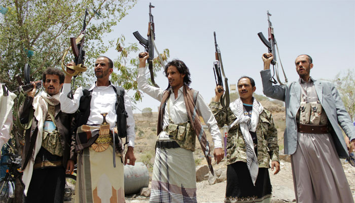 Supporters of the Shia Houthi militia brandish their weapons in Yemen's second largest city of Taiz