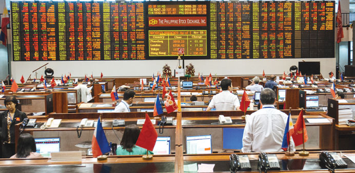 Traders work on the floor of the Philippine Stock Exchange in Manila. The bourse index gained 9.7% i