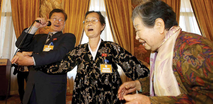 South Korean Nam Joong-nang (right) sings together with her North Korean relatives Ra Myung Seon (ce
