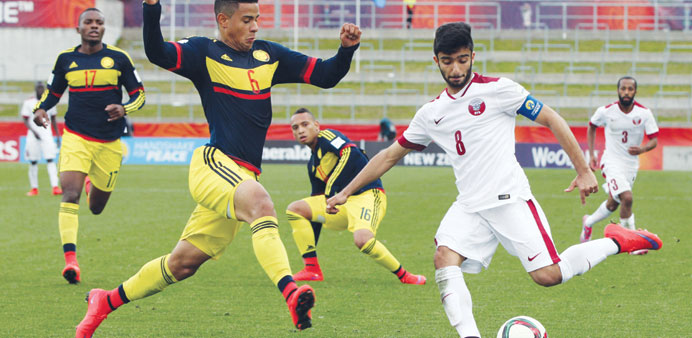 Qatar's Ahmed Moein (right) in action against Colombia