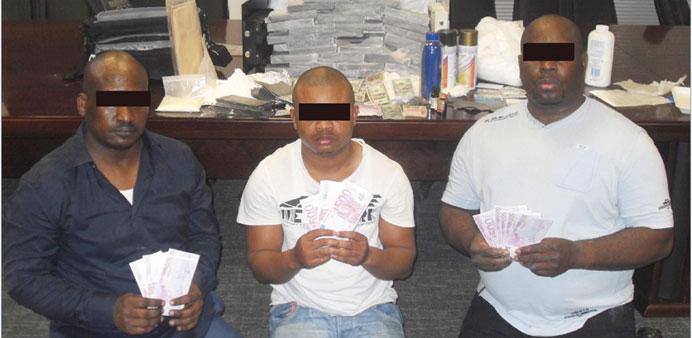 Members of the arrested gang with the fake banknotes.