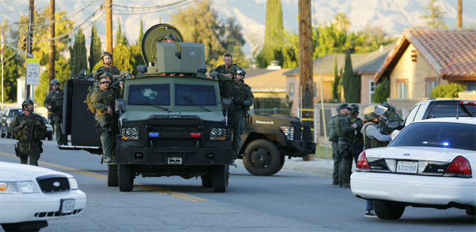 Police officers conduct a manhunt after a mass shooting in San Bernardino, California