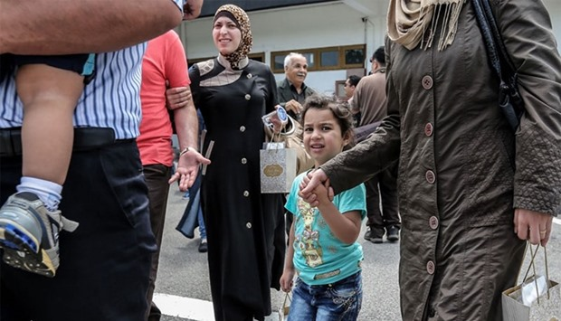 A Syrian migrant family arrives at Subang Air Force base in Subang, outside Kuala Lumpur.
