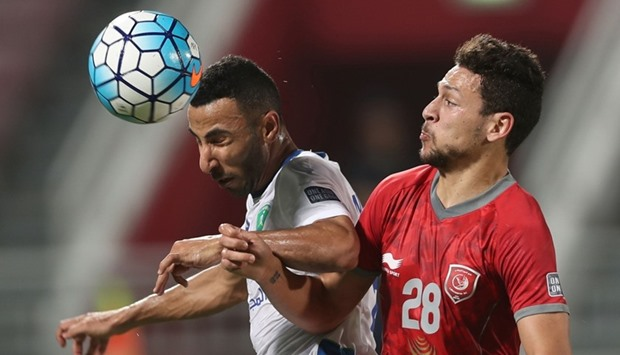 Lekhwiya's player Youssef Msakni (R) fights for the ball