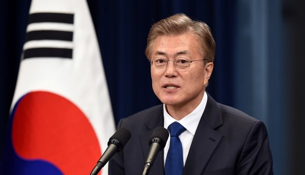 South Korea's new President Moon Jae-In speaks during a press conference at the presidential Blue Ho