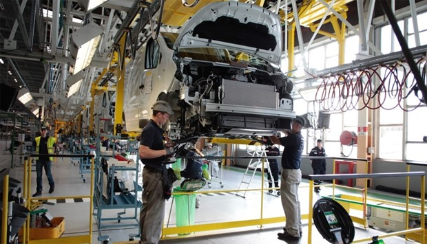 Employees work on the production plant of the French Renault car maker in Sandouville