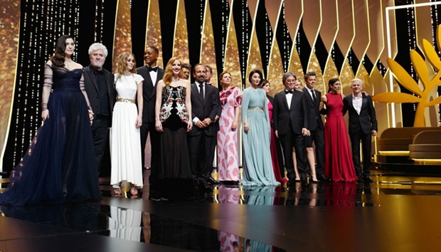 Stars pose on stage during the opening ceremony of the 70th edition of the Cannes Film Festival
