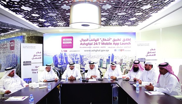 Ashghal officials announcing the launch of the 24/7 mobile apps at a meeting