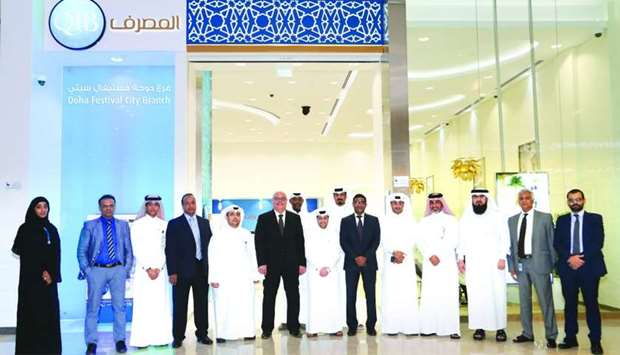 Officials mark the opening of QIB's Doha Festival City branch