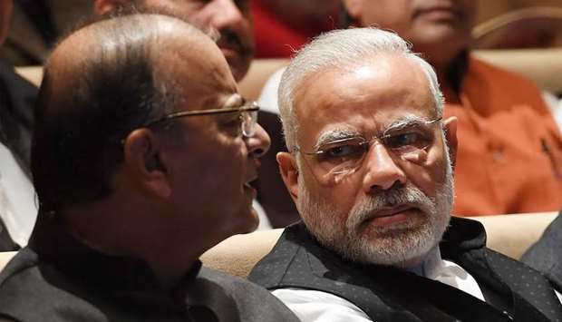 India Prime Minister Narendra Modi (R) speaks with Finance Minister Arun Jaitley (L)