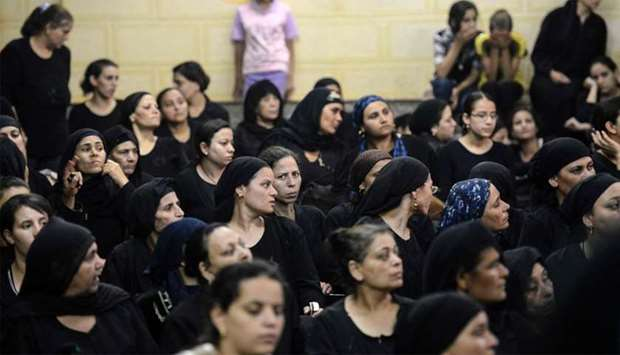 Relatives of killed Coptic Christians grieve as they gather during the funeral at Abu Garnous Cathed