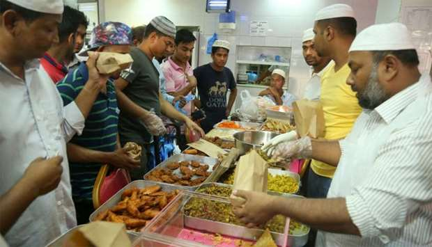 Restaurant staff cater to customers buying iftar food. PICTURE: Jayan Orma