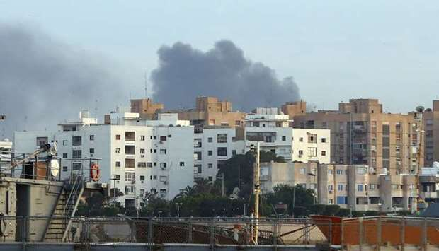 Smoke rises in the center of the Libyan town of Derna
