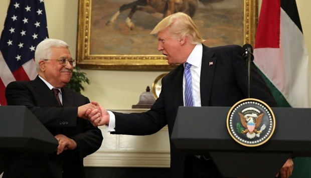 US President Donald Trump shakes hands with Palestinian President Mahmoud Abbas