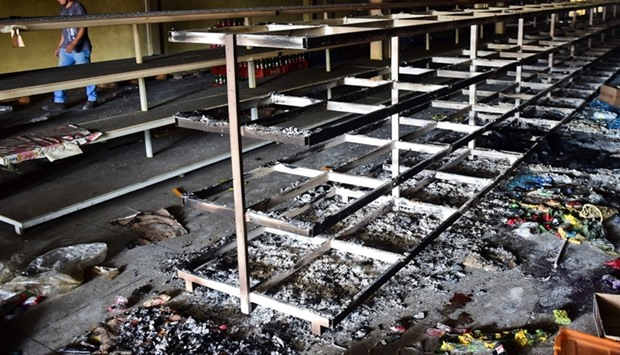 View of damages in a supermarket in Valencia, Carabobo State, the day after anti-government proteste