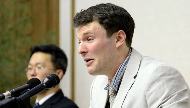 US student Otto Frederick Warmbier (R), who was arrested in North Korea