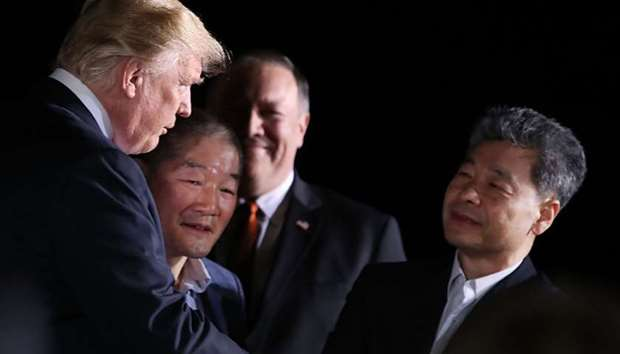 US President Donald Trump stands with Americans just released from North Korea, Kim Dong Chul, Kim H
