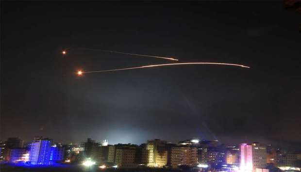 Missiles fire is seen over Damascus