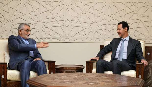 Syrian President Bashar al-Assad (R) receiving the Chairman of Iranian Shura Council's Committee for