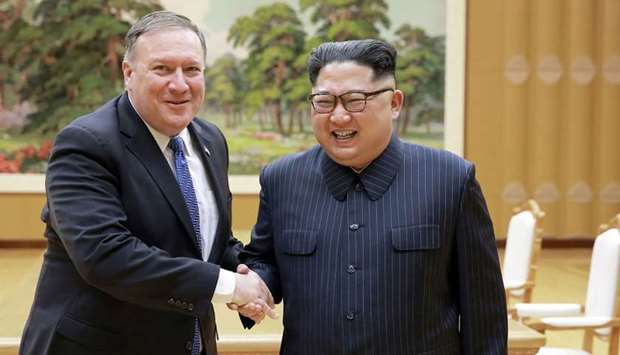 North Korean leader Kim Jong Un (R) and US Secretary of State Mike Pompeo (L) shaking hands