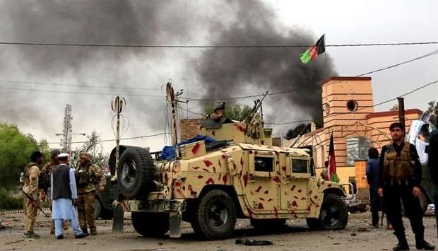 Afghan security forces keep watch during blasts and gunbattle at the site in Jalalabad city