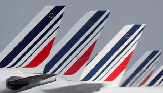 The tails of Air France airplanes parked at the Charles-de-Gaulle airport are seen in Roissy