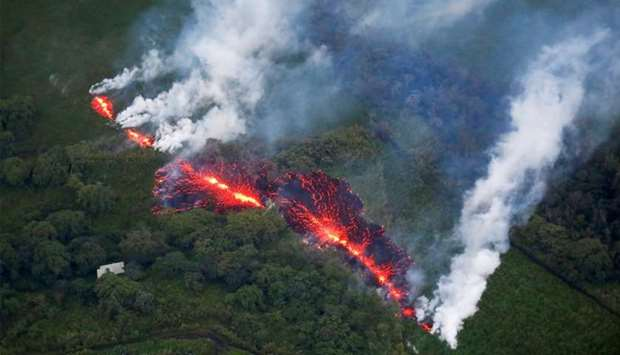 Lava erupts from a fissure east of the Leilani Estates subdivision during ongoing eruptions of the K