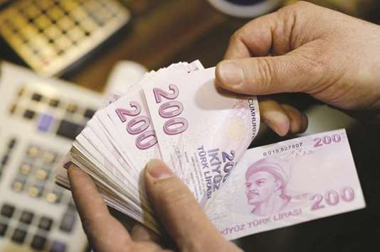 Turkish lira eases as investors hope for central bank action