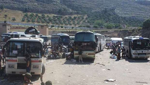 Buses at the Yarmuk Palestinian refugee camp