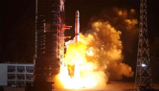 A Long March-4C rocket lifts off from the southwestern Xichang launch centre carrying the Queqiao (""