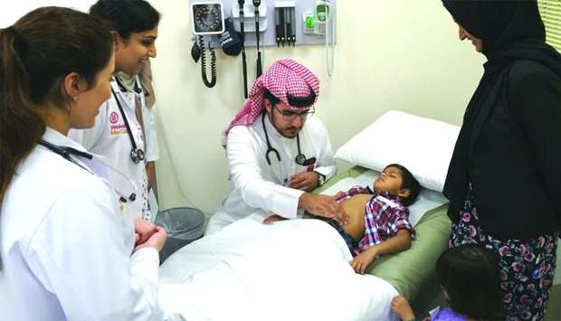 WCM-Q medical student Nasser bin Marzook learns how to conduct a medical examination of a child at t