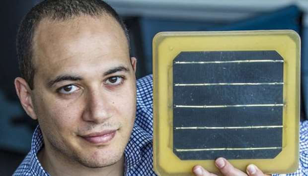 Dr Azmy Gowaid holding a tile. PICTURE: Peter Devlin