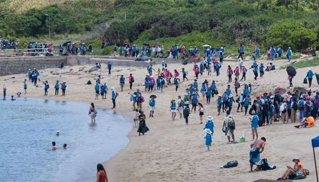 Participants take part in a beach clean-up on Hong Kong's outlying Lamma island