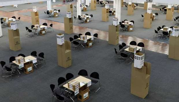 Tables and ballot boxes are set up at a convention centre turned polling station in Bogota, Colombia