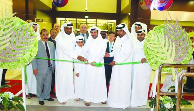 Al Meera officials and other dignitaries during the opening of the company's second branch in Azghaw
