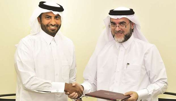Nasser al-Jaber and Dr Ahmed al-Emadi at the MoU signing.