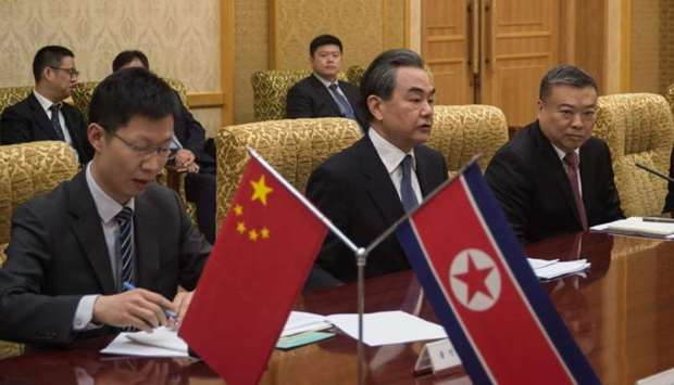 China's foreign minister Wang Yi (C) attends a meeting with North Korea's foreign Minister Ri Yong H