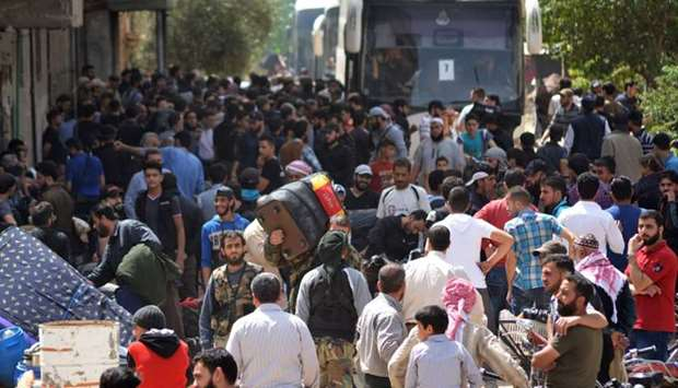 Syrian rebels and civilians prepare to be evacuated from the town of Yalda