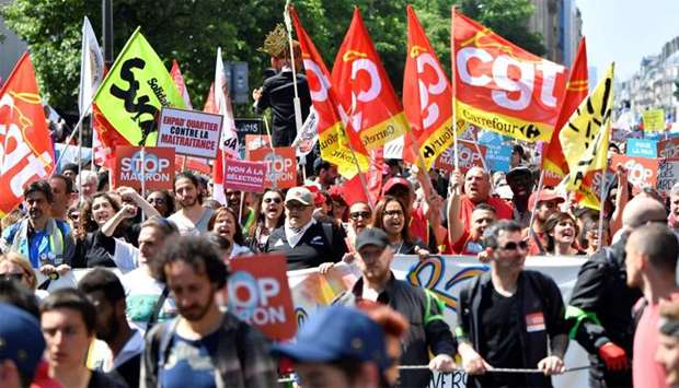 Unionists march during a rally called to protest against policies of the French president on the fir