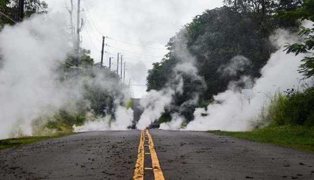 Steam rises from a fissure on a road in Leilani Estates subdivision on Hawaii's Big Island yesterday