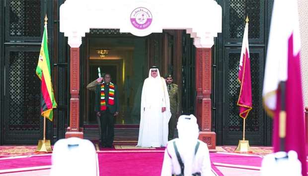 His Highness the Amir Sheikh Tamim bin Hamad al-Thani and Zimbabwe President Emmerson Mnangagwa at t