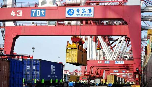 Containers are transferred at the port in Qingdao in China's eastern Shandong province