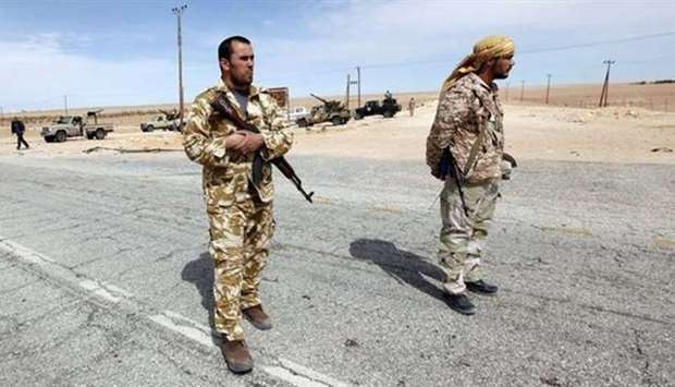 Libyan soldiers at a check point near Sirte