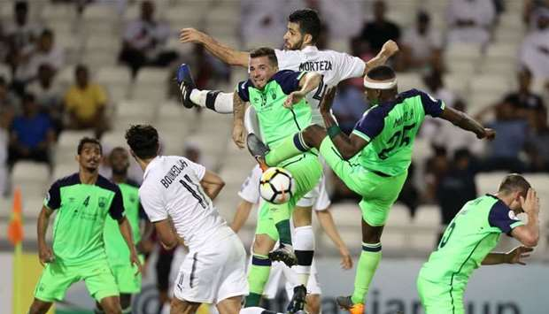 Al-Sadd's Morteza Pouraliganji, Baghdad Bounedjah vie for ball against Al-Ahli's Claudemir de Souza