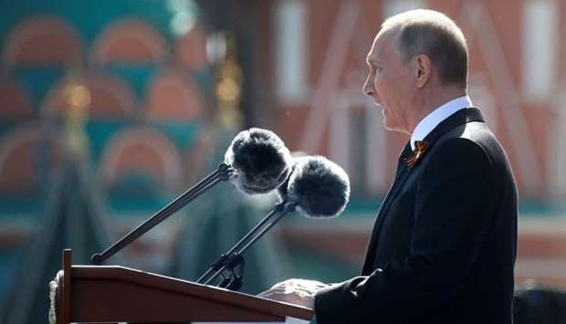 Russian President Vladimir Putin delivers a speech during the Victory Day parade