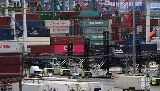 Unloaded containers from Asia are seen at the main port terminal in Long Beach, California